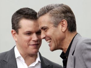 Actors Matt Damon (L) and George Clooney