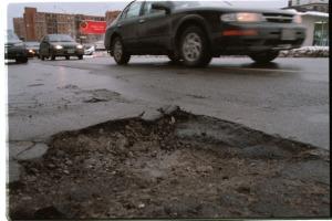 pix of potholes at parlament /front st
