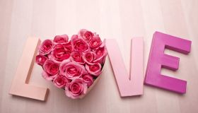 Letters spelling love with roses