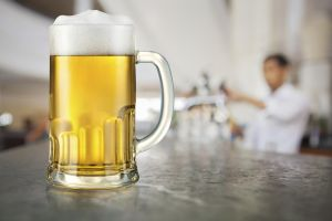 Mug of light beer in pub