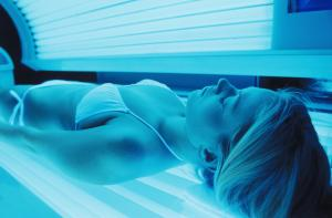 Woman using Tanning Bed