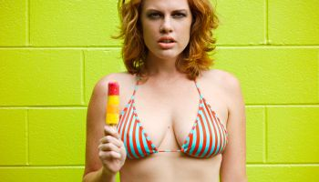 Woman holding popsicle