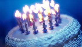tungsten toned close-up of an array of candles on a birthday cake