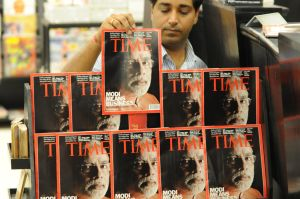 An Indian salesman arranges copies of Ti
