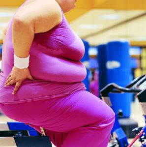 Mid Section View of a Fat Woman on an Exercise Bike