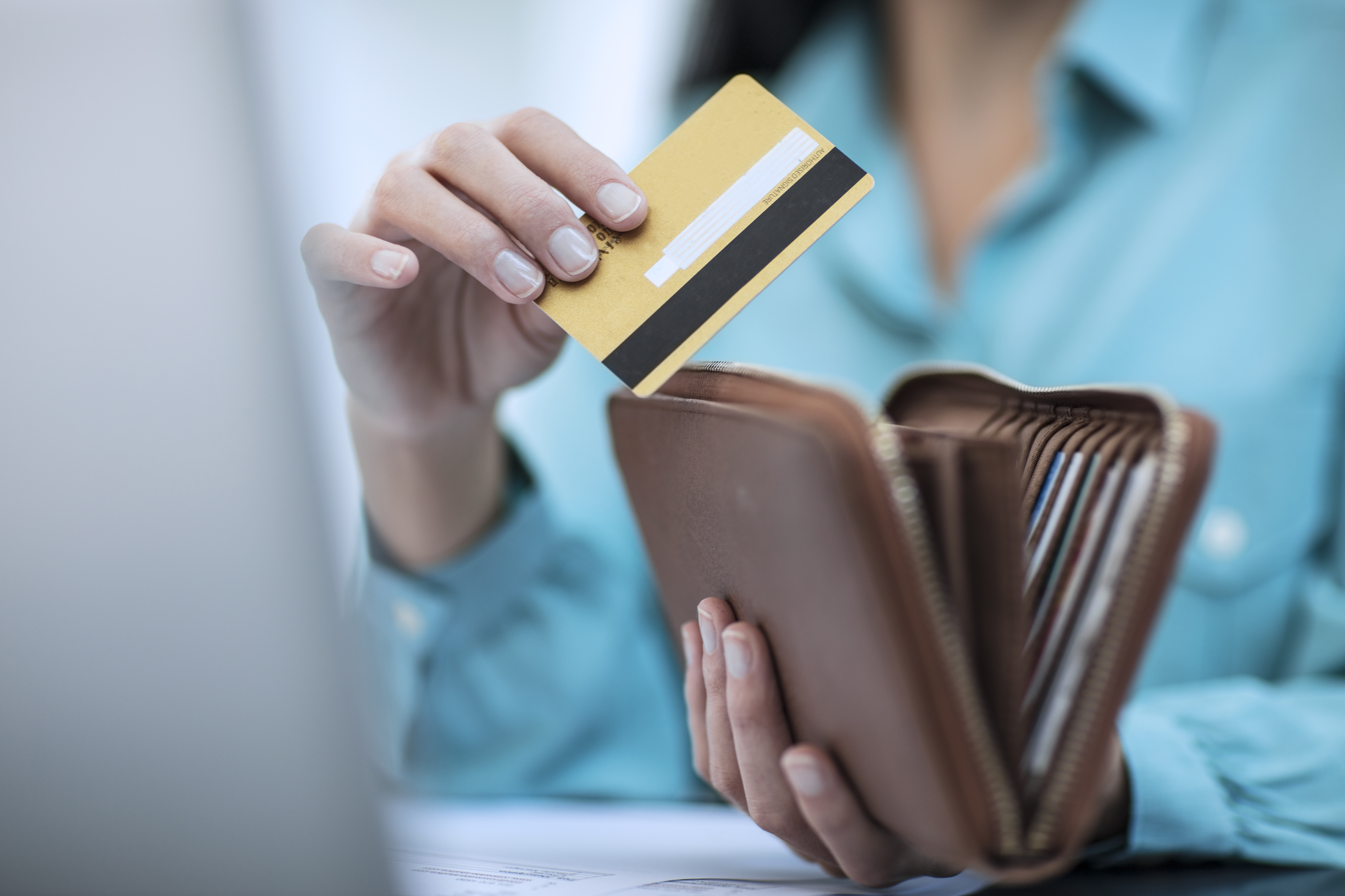 Person with wallet and credit card