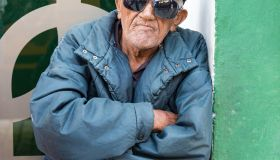 Cuban senior selling Trabajadores newspaper. Elders make...