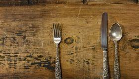 Vintage Silverware on Rustick Grunge Wooden Background