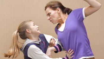 Mother hitting daughter