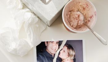 Ripped photograph next to ice cream and tissues