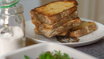 Toasted Bread Served In Plate On Table