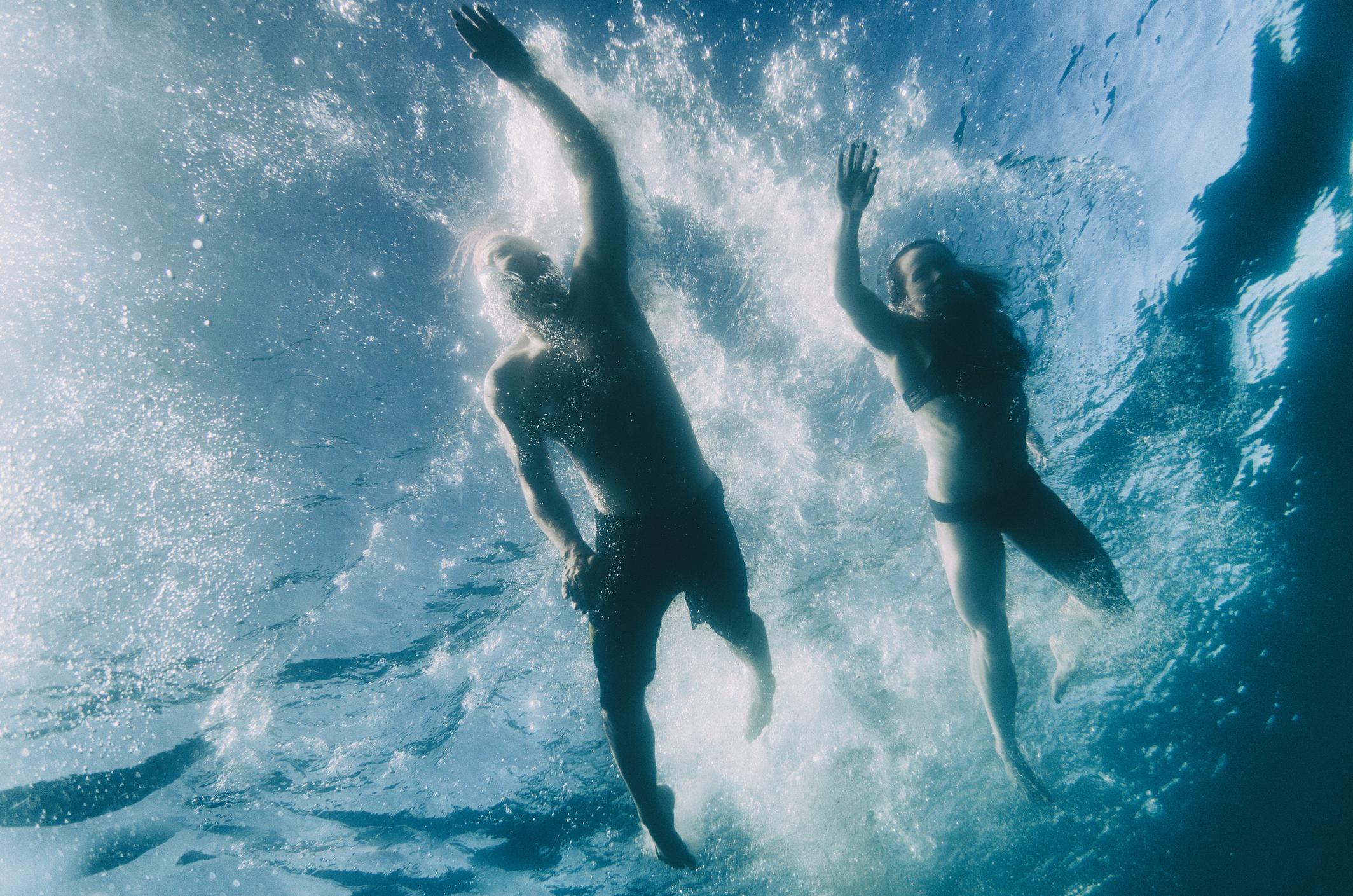 Two people swimming in Lake Tahoe, California