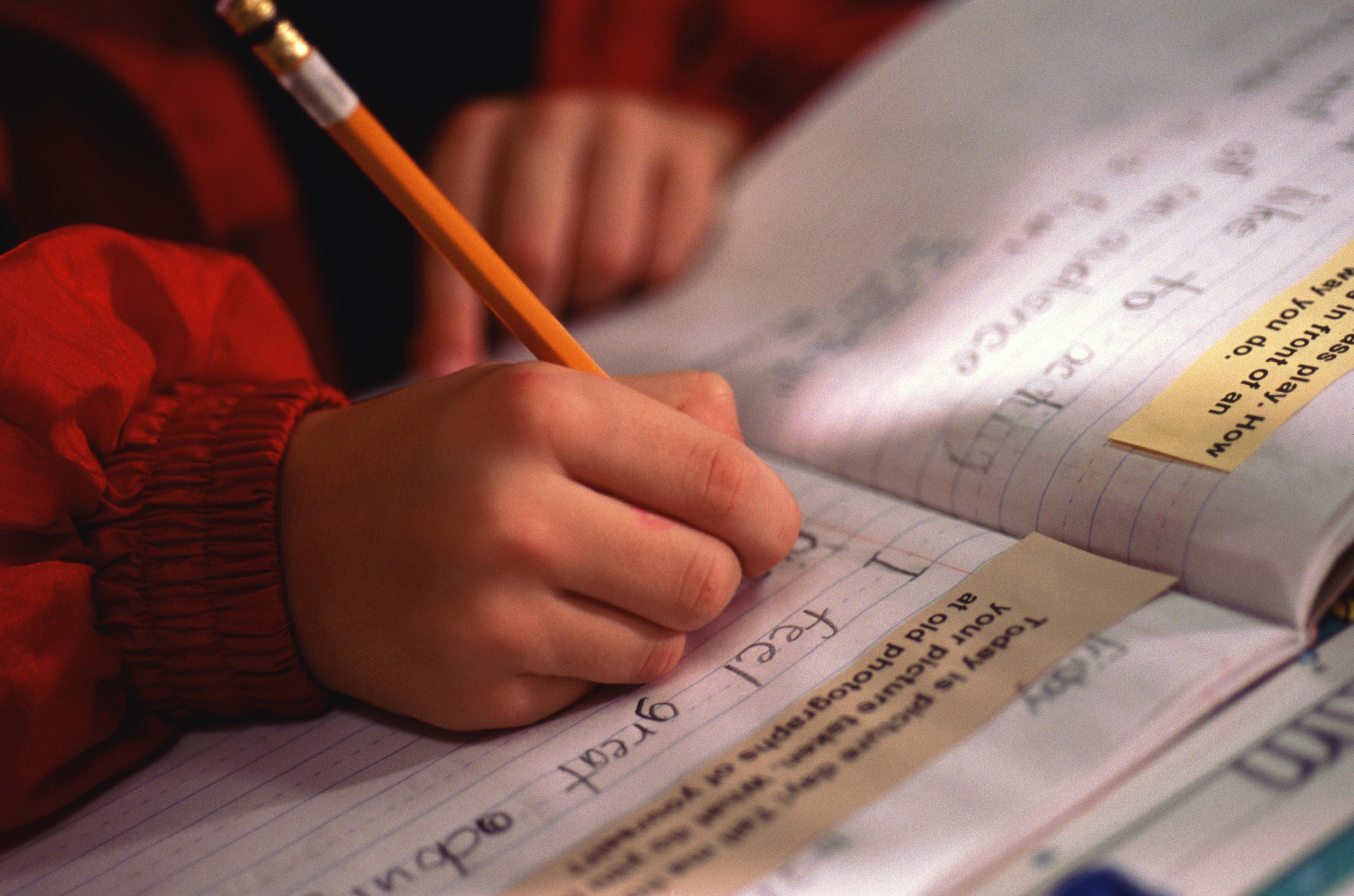 Boy doing homework, mid section
