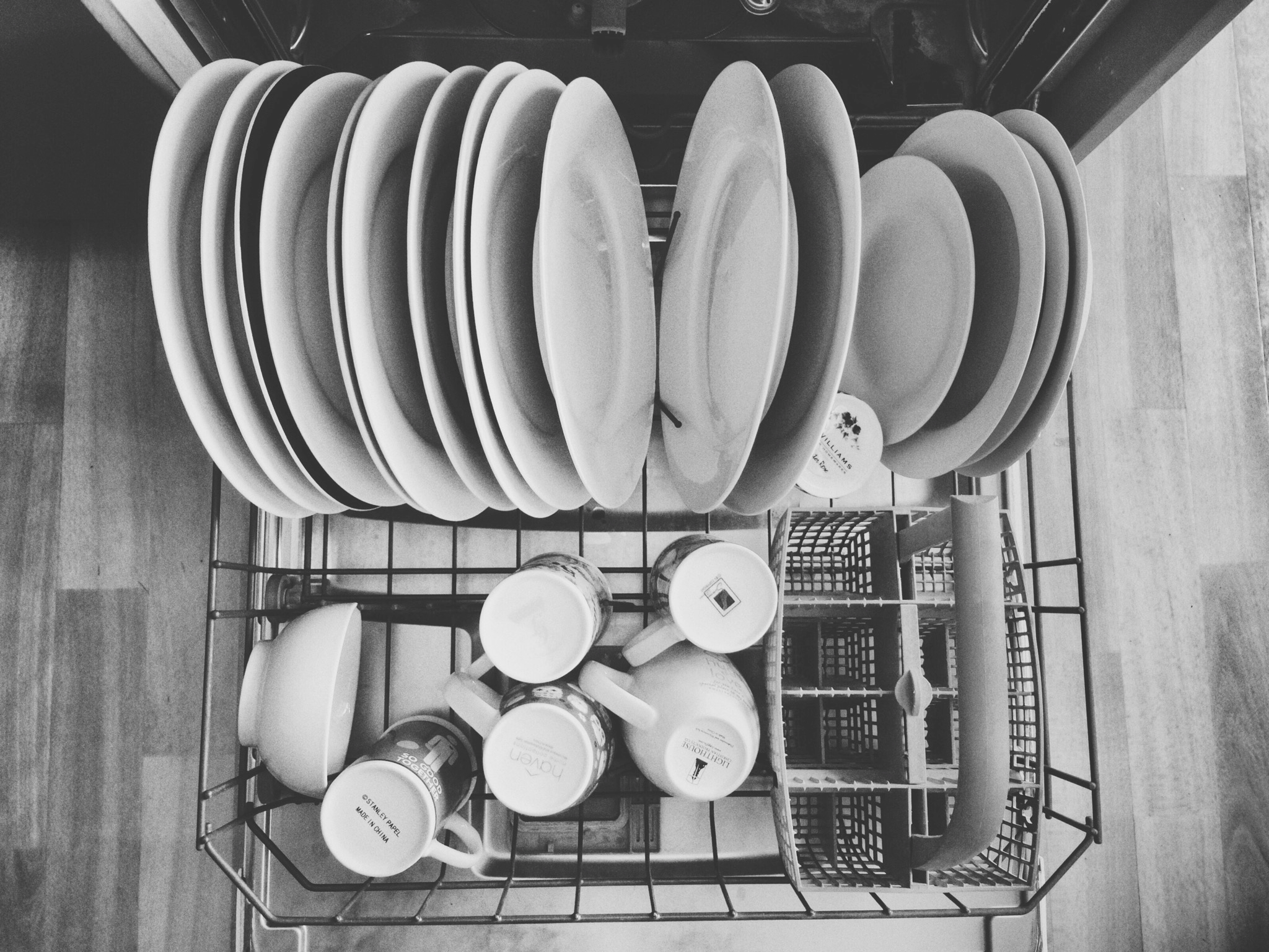 High Angle View Of Utensils In Dishwasher