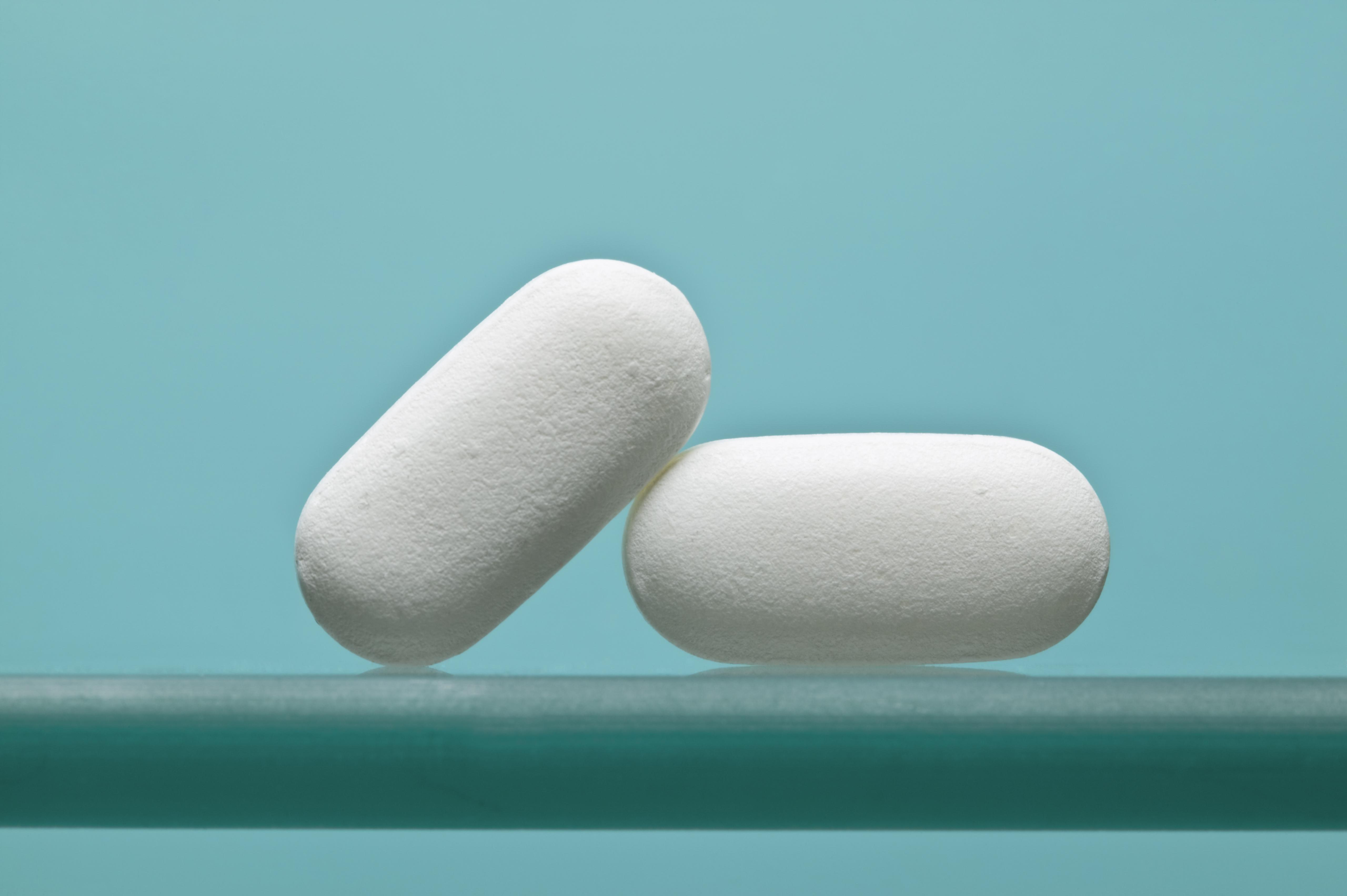 Two pills leaning against each other