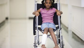 African American girl sitting in wheelchair