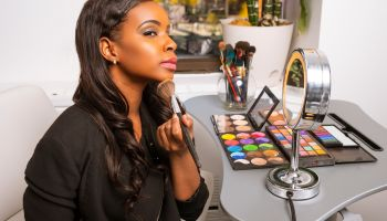 African American Woman Doing Makeup