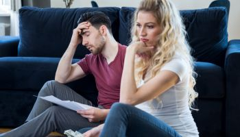 Young couple worried for taxes and family budget