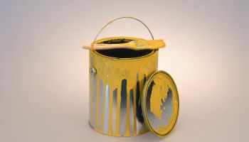 Paint can and brush w/ yellow paint