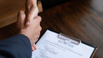 Cropped Hand Of Manager Shaking Hand With Person During Interview At Office