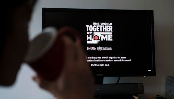 People Watch 'One World: Together At Home' In Hong Kong